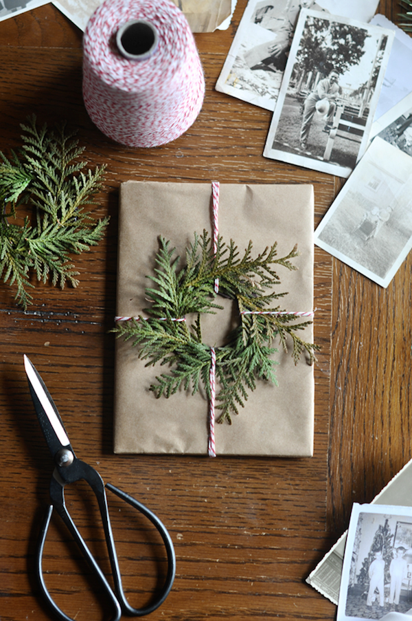 Wrapped present with evergreen wreath.