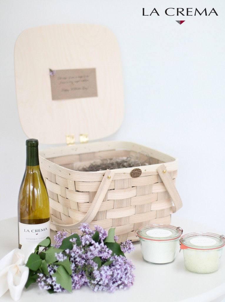 wine, lilacs, bath milk and a basket