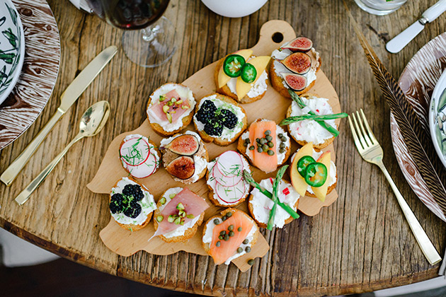 crostini-7-ways-on-a-wood-table