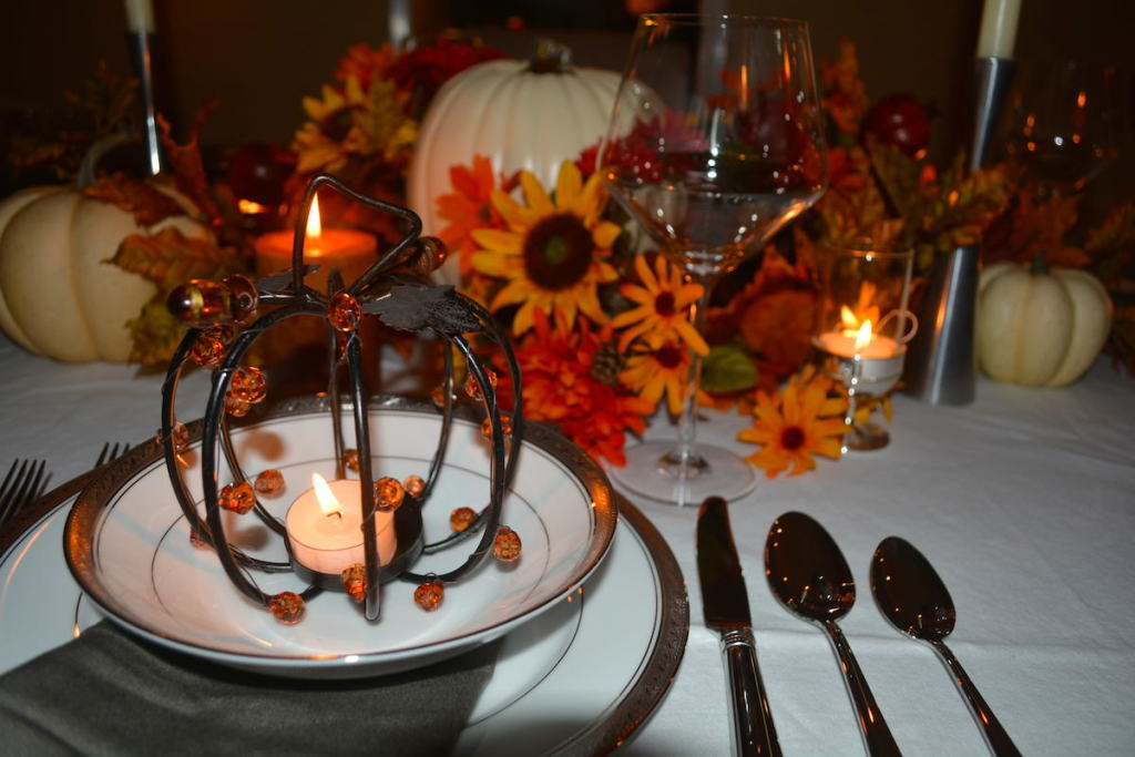 Flickering pumpkin votives set the tone for an intimate dinner party.