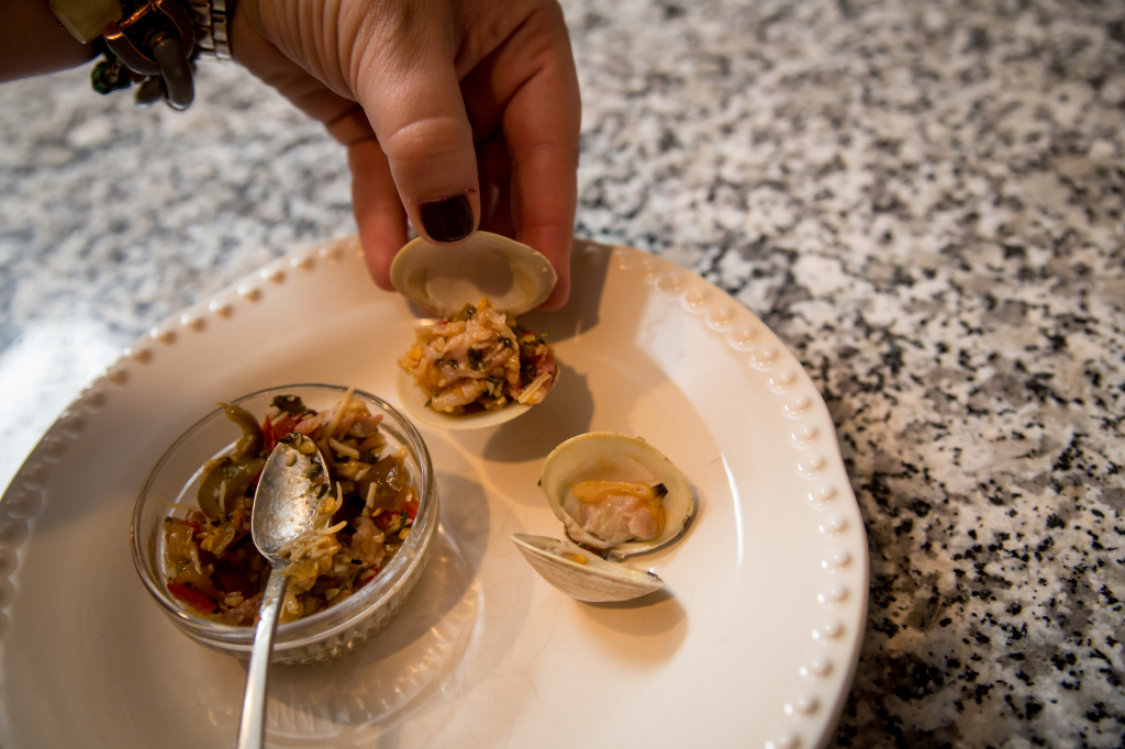 Clams Casino with Pancetta: Portioning the clams into each shell.