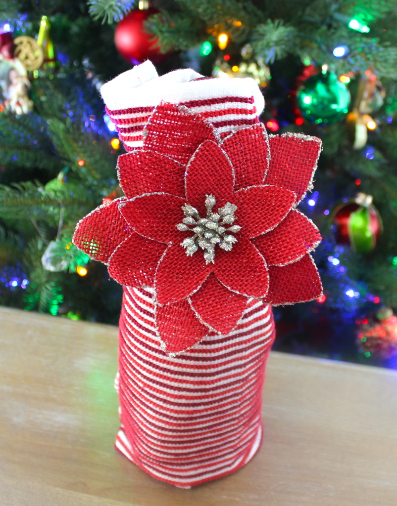 Wine wrapped in a dish towel and ornament: One of four easy DIYs to wrap a bottle of wine in another present this holiday season.