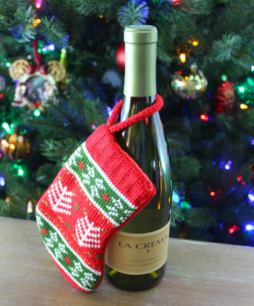 Wine with a mini stocking: One of three easy DIYs to wrap a bottle of wine in another present this holiday season.
