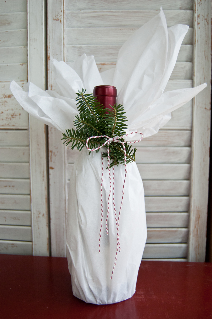 With just a touch of tissue, a twist of twine and a few sprigs of rosemary or evergreen, this bottle is ready for a classy affair.