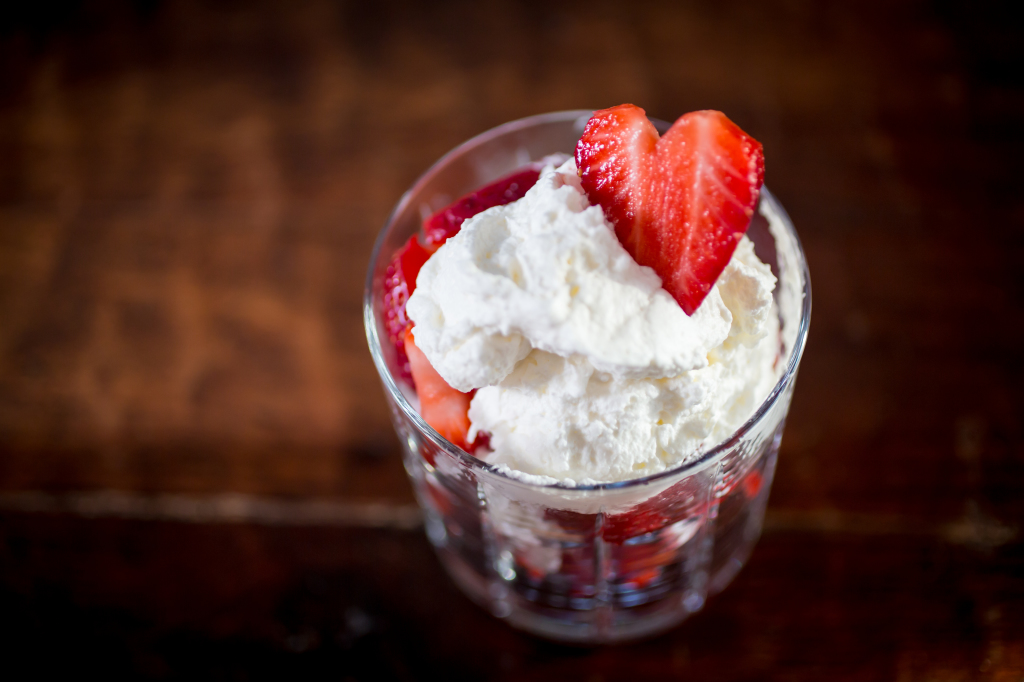 Strawberry parfait with a heart-shped berry garnish