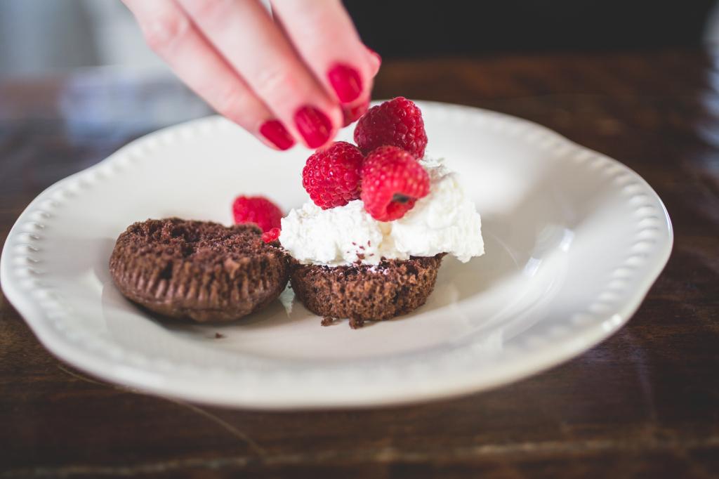 Homemade chocolate cupcakes stuffed with berries and cream