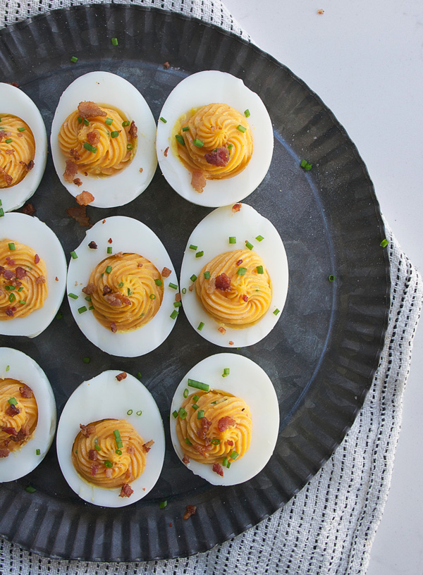 Sriracha Deviled Eggs with Crumbled Bacon: Spicy, creamy, smokey ... what else do you need in an appetizer?