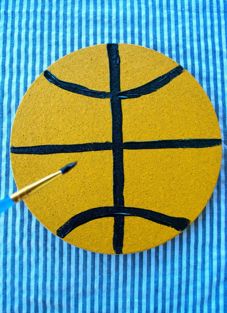 NCAA tournament party planning: Painted wine coaster DIY.