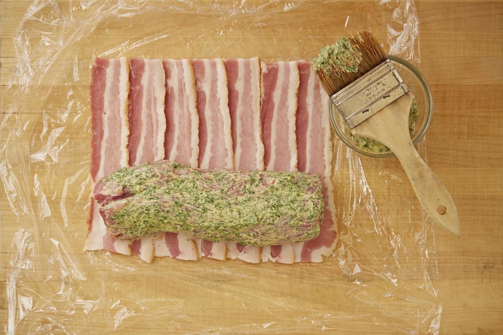 How to wrap bacon around a pork tenderloin.