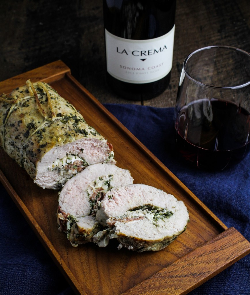 Prosciutto, Mozzarella & Sage Pesto Stuffed Pork Tenderloin: This stuffed and rolled pork tenderloin may not be strictly traditional, but it takes all of its inspiration from Italian cuisine. Butterflied and filled with layers of sage and rosemary pesto, fresh mozzarella cheese and prosciutto, then rolled up and roasted to juicy perfection. #recipe