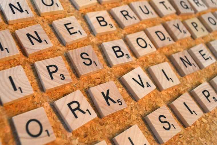 DIY Wine Words Coaster: Arrange your tiles to make sure all of your words are spelled out correctly.