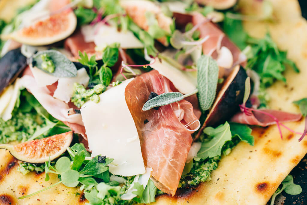 Flatbread with Sage  Arugula Pesto, Figs, and Prosciutto