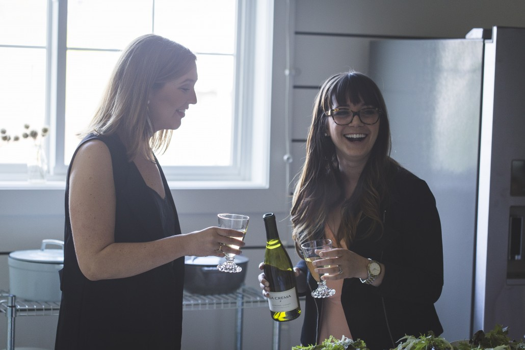 Annie Reeves and Megan Flynn Peterson of Freckled Italian cheersing with La Crema Sonoma Coast Chardonnay