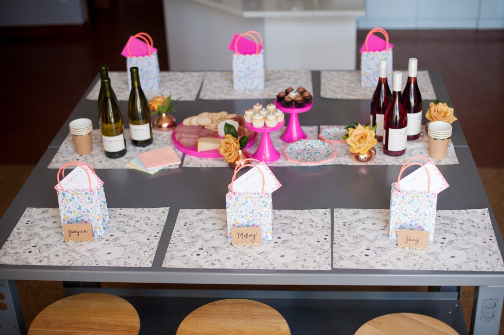 Table design with wine, snacks goodies and place settings for a flower arranging class
