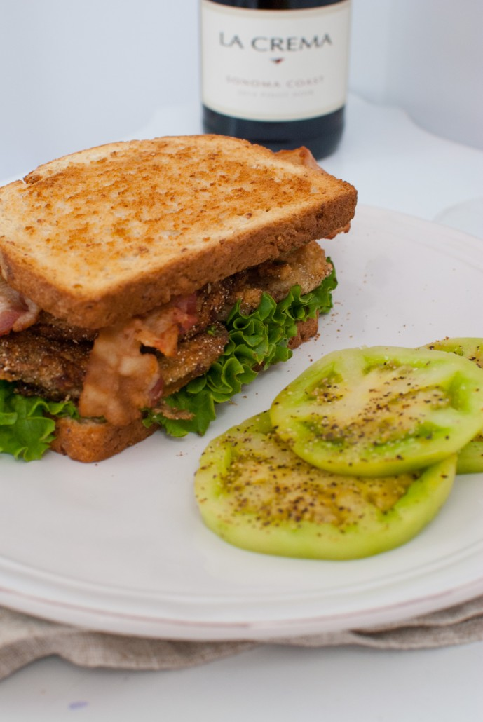 Fried Green Tomato BLT with fresh green tomatoes on the side