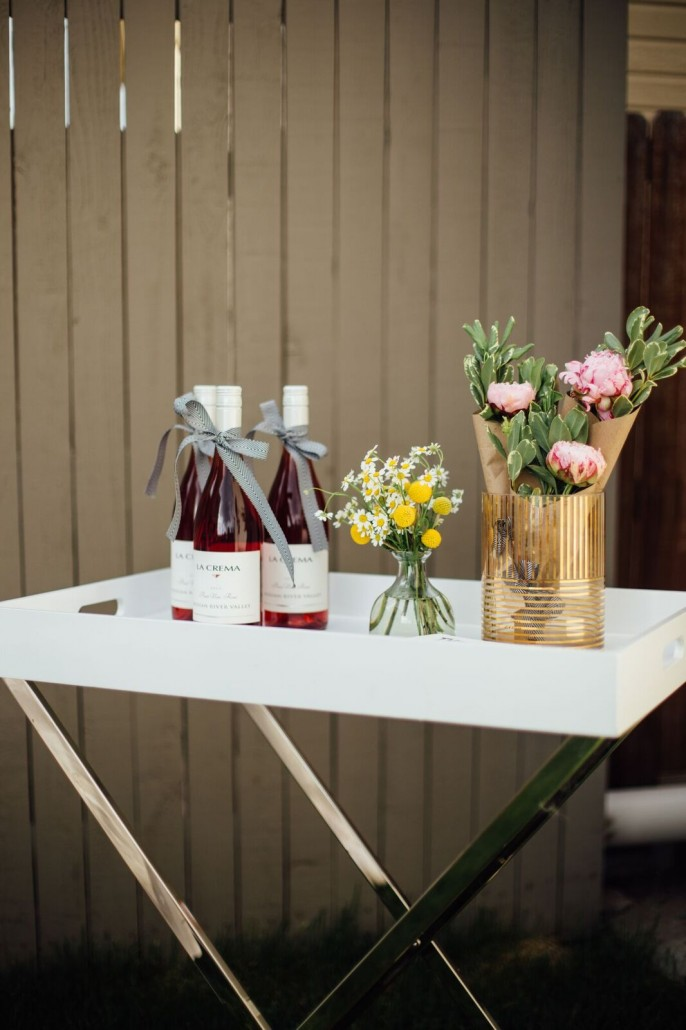 Dress up your bar cart with flowers and have wine ready at your bridal shower