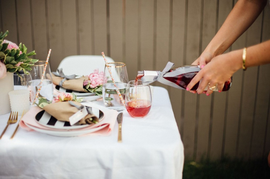 Fill themed glasses with rosé at your bridal shower