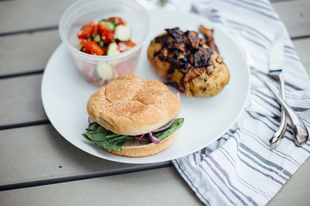 Glamping Meal: Carmelized onion baked potato burger and zucchini, tomato and parmesan salad