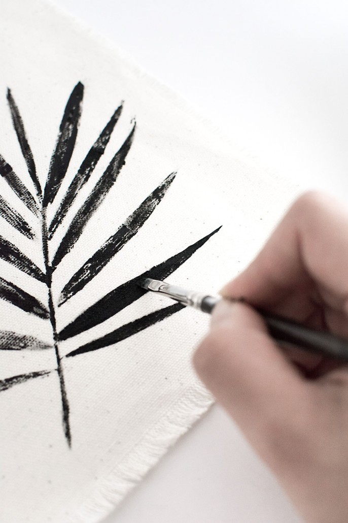 Fill in the leaf with black paint to create DIY Palm Leaf Napkins with a graphic look