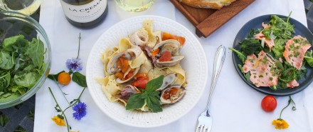 Italian Seafood Dinner: Seafood Pasta with Squid, Clams, and Tomatoes