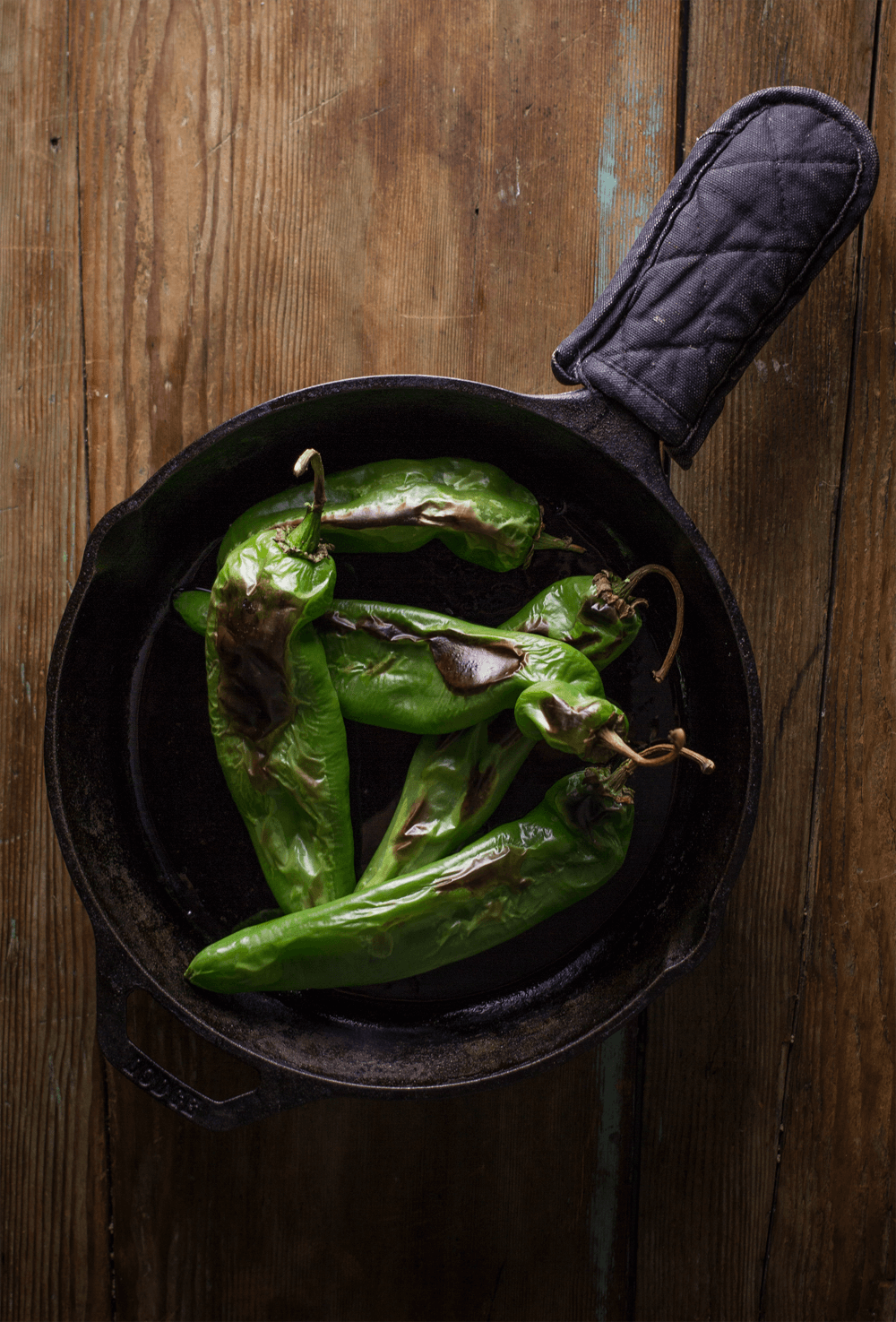 Roasted Hatch Chile Burger: roast the hatch chiles in a cast iron pan.