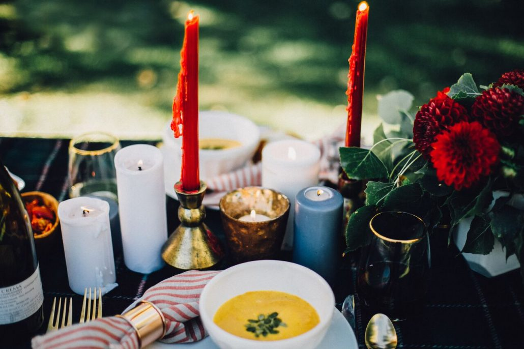 Lots of candles create an inviting setting for a fall al fresco dinner party