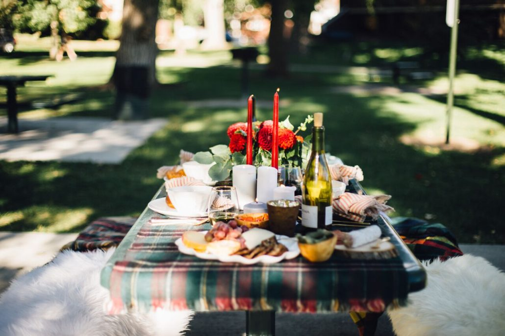 Beautiful plaid tablescape for a fall al fresco dinner party