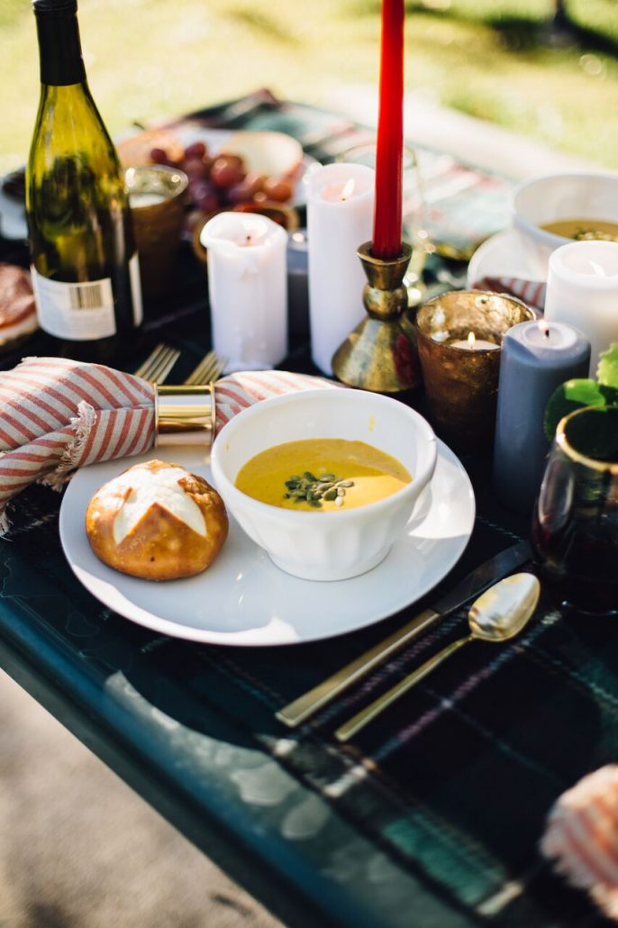 Butternut squash soup and a pretzel roll for a fall al fresco dinner party