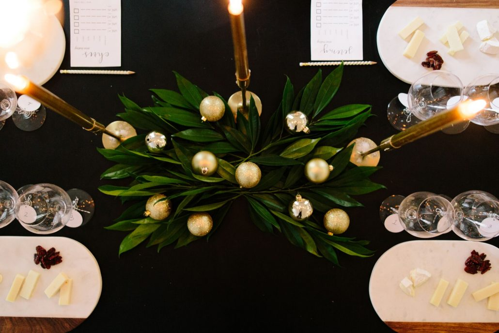 Festive centerpiece with leaves and gold ornaments for a blind wine tasting