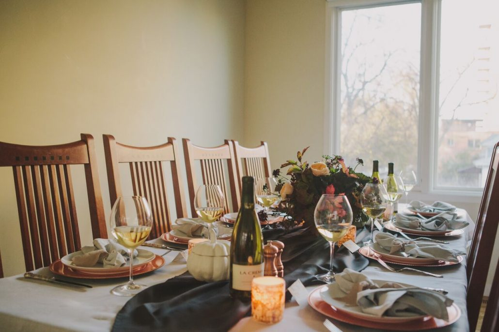 Table is set for a Friendsgiving! Keep things organized and if you're tight on space, go light on the centerpiece so there's more room for the dishes.