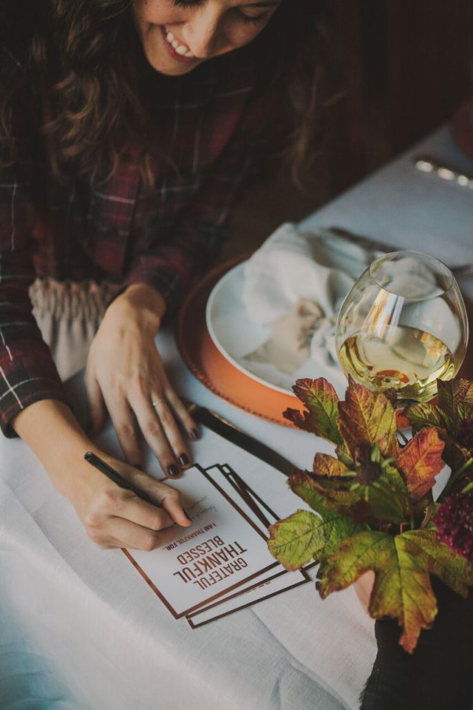 Include cards where guests can write down what they're thankful for at your Friendsgiving