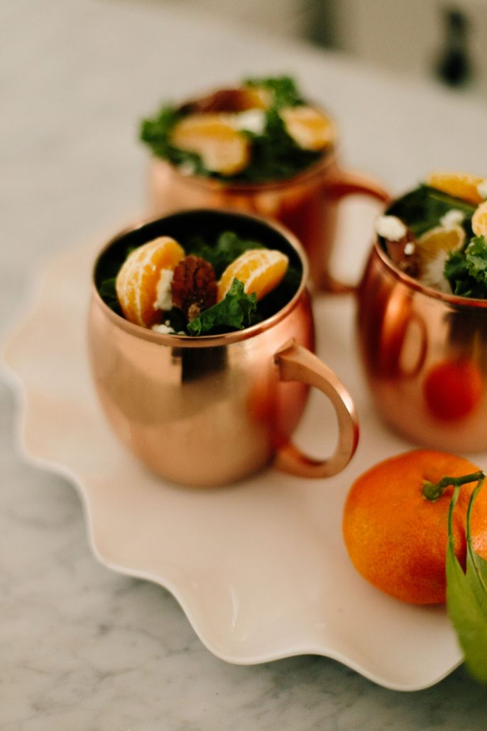 Kale, Clementine and Goat Cheese Salad festively served in Moscow Mule mugs for a New Year's Day Brunch