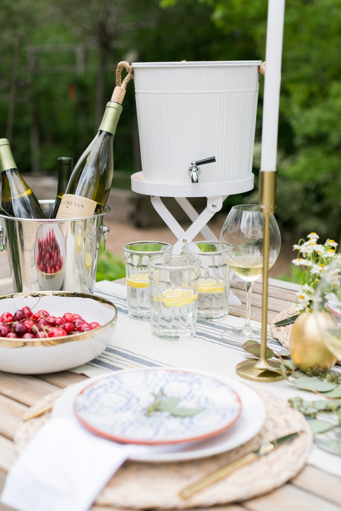 3. When it comes to patio dining it's best to prepare for the outdoor elements. Keep the Monterey Chardonnay cool by putting it in a bucket filled with ice on the table. That way you don't have to go back and fourth inside to get cooled wine. And don't forget to always set out a wine opener on the table! 4. Make sure there is plenty of water! If it's a warm evening there is nothing worse than parched guests. Keep a drink dispenser of water and some lemons out on the table so guests can help themselves to fresh water throughout the evening. 5. Lastly, summer flavors are a must! One of my favorite parts about summer is all the delicious fresh vegetables and fruits that come out. Set out cherries in a bowl on the table for guests to munch on. Pair a goat brie cheese with a ginger peach jam to go with the Monterey Pinot Noir!