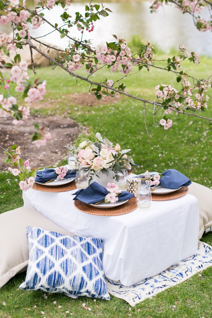 Pull together pillows and an outdoor rug to make things cozy at your spring picnic