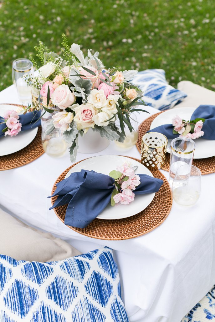 Table setting for a spring picnic in a park or backyard