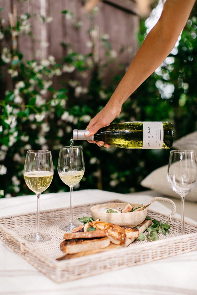 Chardonnay paired with a burrata dish as a start at a low-key dinner party by Camille Styles